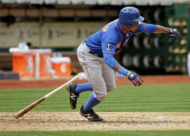 New York Mets' Curtis Granderson hits an RBI single off Oakland Athletics starting pitcher Jeff Samardzija in the fourth inning of their interleague baseball game Wednesday, Aug. 20, 2014, in Oakland, Calif. The Mets' Wilmer Flores scored on the play. (AP Photo/Eric Risberg) ORG XMIT: OAS110 Photo: Eric Risberg / AP