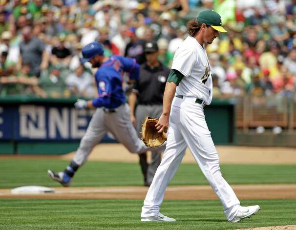 Oakland Athletics starting pitcher Jeff Samardzija, right, walks back to the mound after giving up a three run homer to the New York Mets' Lucas Duda, left, during the third inning of their interleague baseball game Wednesday, Aug. 20, 2014, in Oakland, Calif. (AP Photo/Eric Risberg) ORG XMIT: OAS108 Photo: Eric Risberg / AP