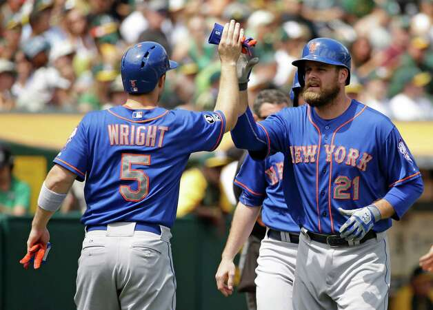New York Mets' Lucas Duda, right, is greeted by teammate David Wright, left, after hitting a three run homer off Oakland Athletics starting pitcher Jeff Samardzija in the third inning of their interleague baseball game Wednesday, Aug. 20, 2014, in Oakland, Calif. (AP Photo/Eric Risberg) ORG XMIT: OAS107 Photo: Eric Risberg / AP