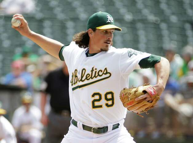 Oakland Athletics starting pitcher Jeff Samardzija throws in the first inning of their interleague baseball game against the New York Mets Wednesday, Aug. 20, 2014, in Oakland, Calif. (AP Photo/Eric Risberg) ORG XMIT: OAS102 Photo: Eric Risberg / AP
