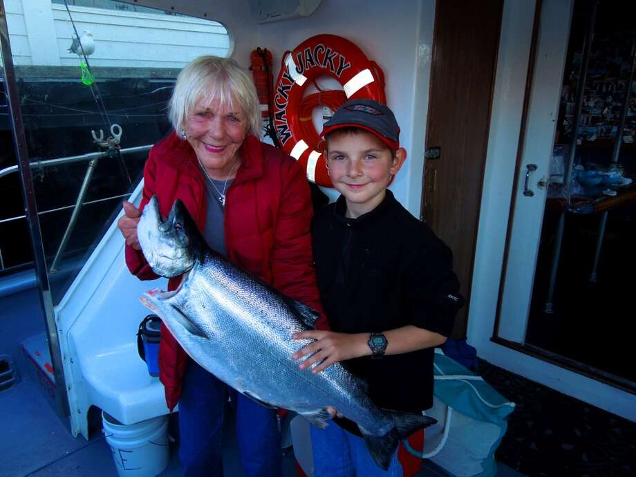 Capt. Wacky Jacky and 8-year-old Bill Pantone with his first salmon Photo: Brian Murphy, Special To The Chronicle