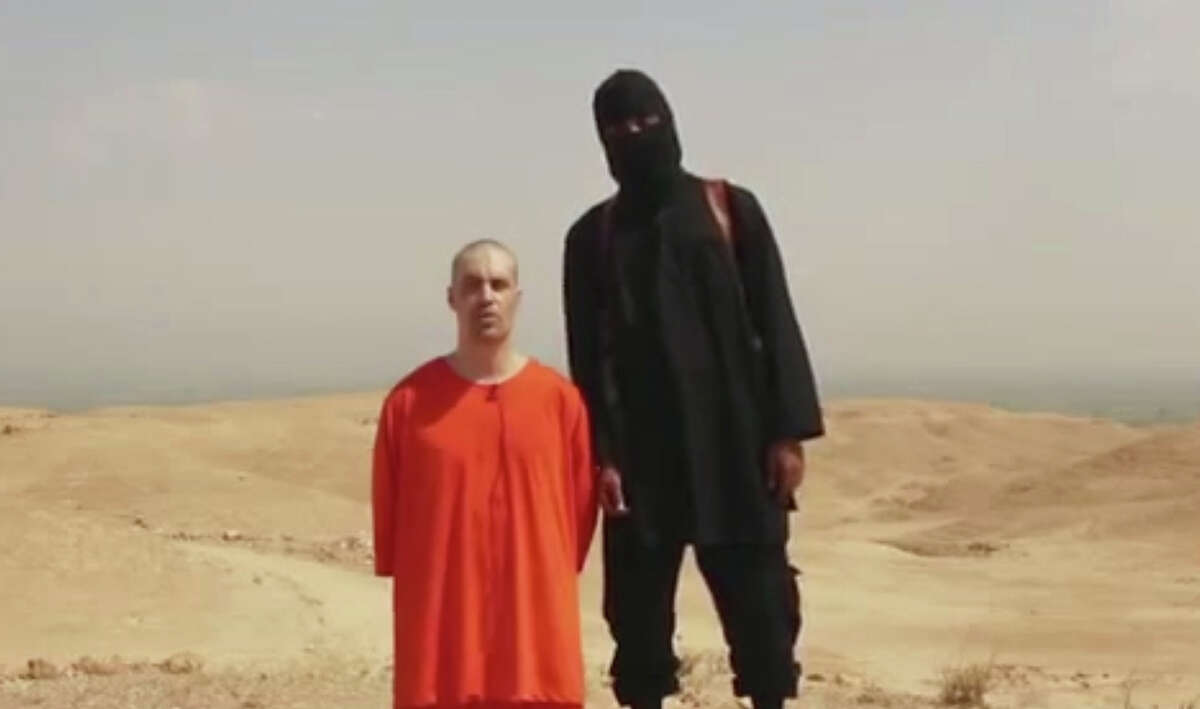 This undated image shows a frame from a video released by Islamic State militants Tuesday, Aug. 19, 2014, that purports to show the killing of journalist James Foley by the militant group. Foley, from Rochester, N.H., went missing in 2012 in northern Syria while on assignment for Agence France-Press and the Boston-based media company GlobalPost. The U.S. Department of Homeland Security is refuting several claims peddled by conservative groups and lawmakers that militants for the Islamic State in Iraq and Syria are operating just south of the Texas-Mexico border.