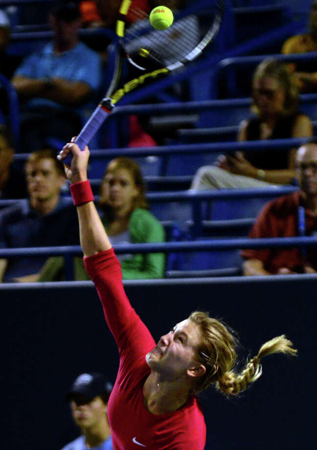 Eugenie Bouchard serves to opponent Samantha Stosur, during Connecticut Open tennis action in New Haven, Conn. on Wednesday August 20, 2014. Stosur went on to beat Bouchard 6-2, 6-2. Photo: Christian Abraham / Connecticut Post