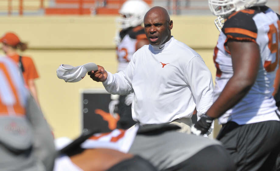 Long before practice starts, Texas coach Charlie Strong is running the streets of Austin in the wee hours, alone with his thoughts and sorting through the challenges of the job. Photo: Robin Jerstad, Freelance