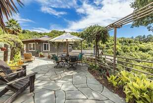 The back patio provides ample room for gardening and entertaining.