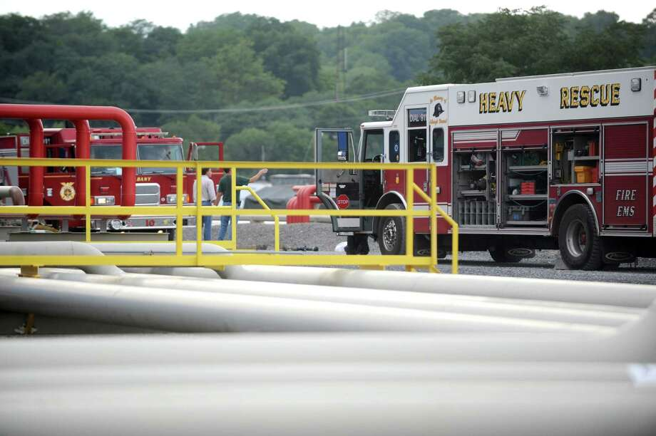 Emergency responders work a spill of about 100 gallons of oil spilled at the Global Partners tank farm site at the Port of Albany on Wednesday Aug. 20, 2014 in Albany, N.Y. (Michael P. Farrell/Times Union) Photo: Michael P. Farrell / 00028273A