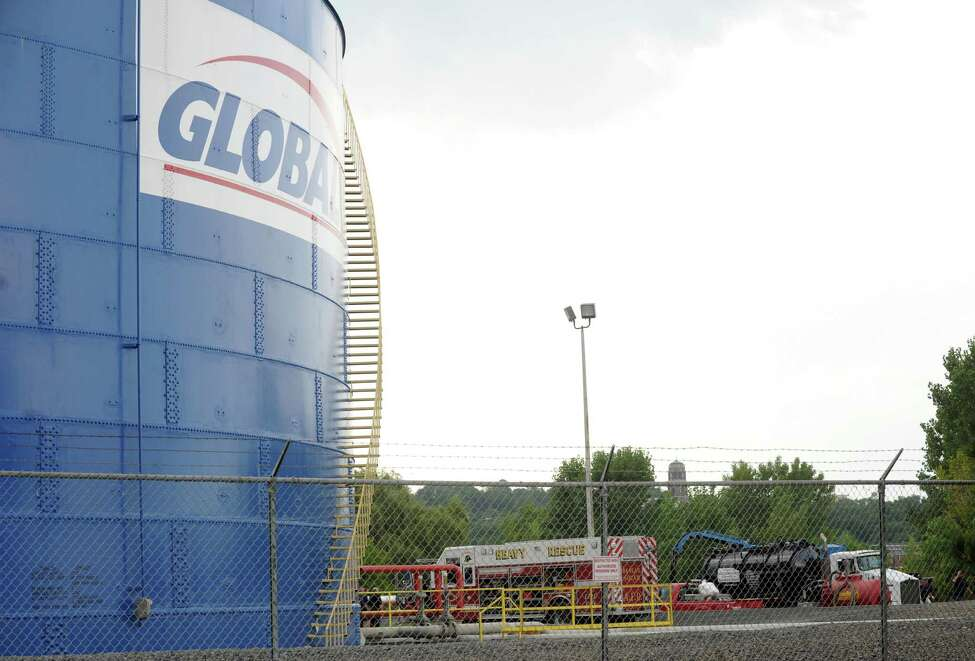 Emergency responders work a spill of about 100 gallons of oil spilled at the Global Partners tank farm site at the Port of Albany on Wednesday Aug. 20, 2014 in Albany, N.Y. (Michael P. Farrell/Times Union)