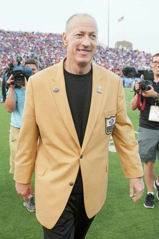 CANTON, OH - AUGUST 3: Jim Kelly walks off the field after participating in the coin toss prior to the game between the Buffalo Bills and the New York Giants at the 2014 NFL Hall of Fame Game at Fawcett Stadium on August 3, 2014 in Canton, Ohio. (Photo by Jason Miller/Getty Images) ORG XMIT: 501566627 Photo: Jason Miller / 2014 Getty Images