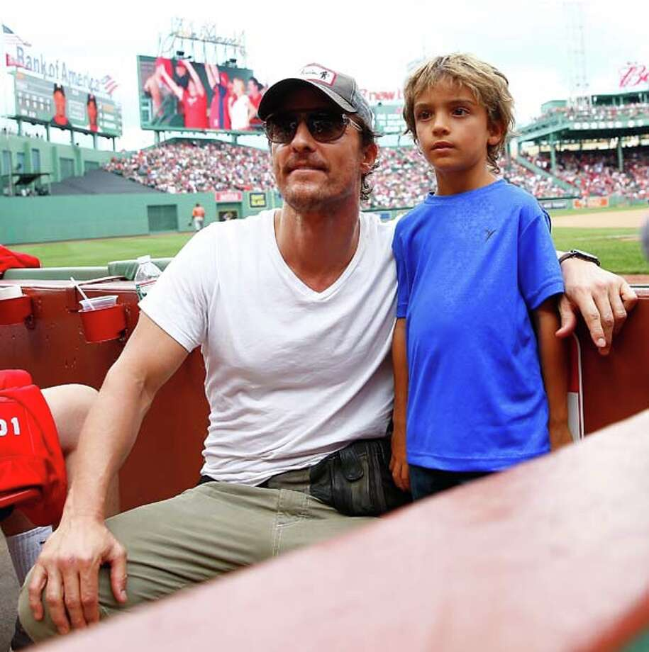 If you want to look hot in a fanny pack, it helps to be Matthew McConaughey. He bragged about his love for waist-oriented baggage on Sunday, Aug. 17 while taking in a Houston Astros away game with his son Levi at Boston's Fenway Park.One great thing about the fanny pack - you don't have to take it off when you stand up for the national anthem.Keep clicking for some other ways you can wear this hands-free hip accessory. Photo: Jared Wickerham, Getty Images / 2014 Getty Images