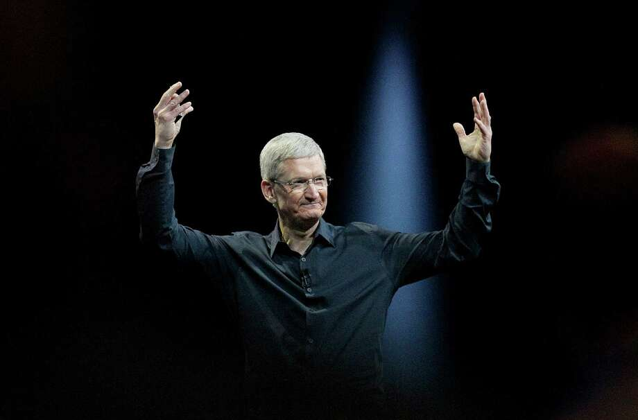 FILE - In this June 2, 2014 file photo, Apple CEO Tim Cook gestures during the Apple Worldwide Developers Conference in San Francisco. Apple's stock touched a new high Wednesday, Aug. 20, 2014, reflecting investors' renewed faith in Cook's ability to outwit the competition and expand the technological hit factory built by the late Steve Jobs. (AP Photo/Jeff Chiu, File) Photo: Jeff Chiu, Associated Press File Photo / AP