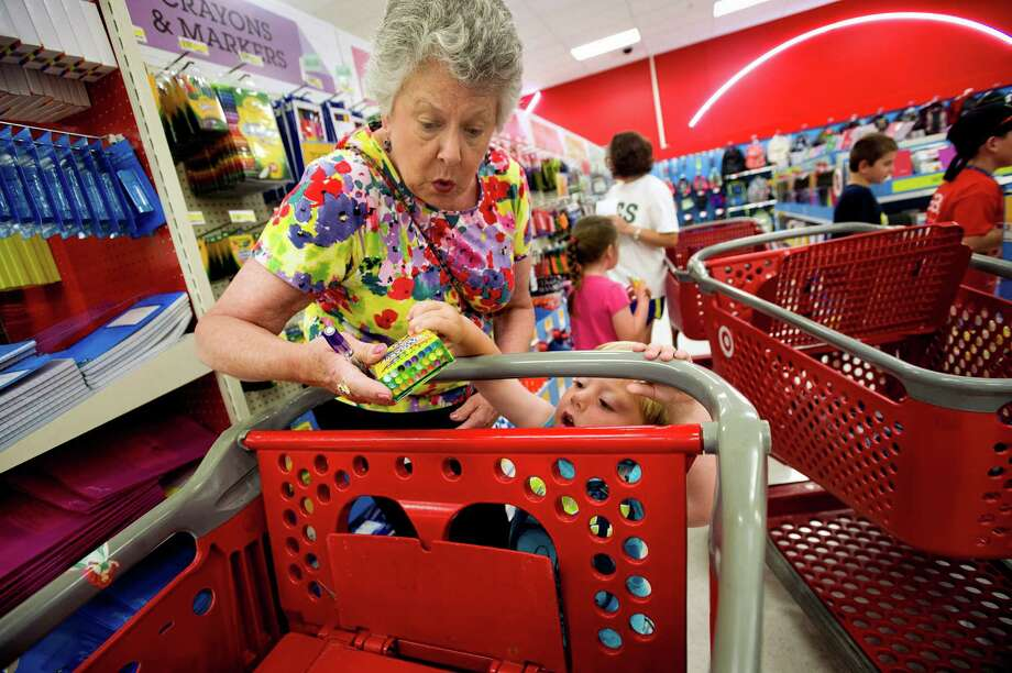 Back-to-school shoppers, like Julie Wilkins and her grandson Griffin in Memphis, Tenn., helped Target stores open at least a year to post positive revenue for six weeks in a row.  The National Retail Federation said it expects the average family with school-age children will spend $669.28 for the 2014 back-to-school season. Photo: Brandon Dill, MBO / The Commercial Appeal