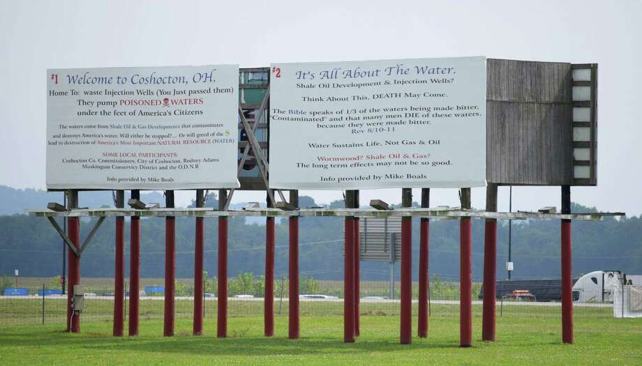 Austin-based Buckeye Brine alleges these billboards in Ohio contain false and defamatory attacks against the company's disposal of gas-drilling wastewater. Photo: Robert A Franco, HONS / Robert A Franco