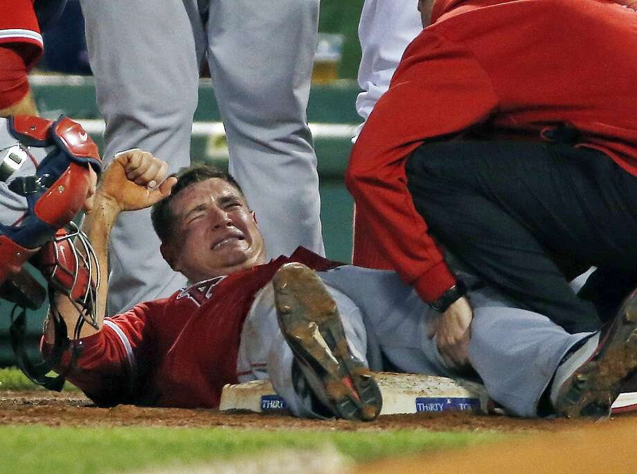 Angels starting pitcher Garrett Richards injured his knee while trying to cover first base in the second inning of a game against the Red Sox at Fenway Park. Photo: Elise Amendola, Associated Press