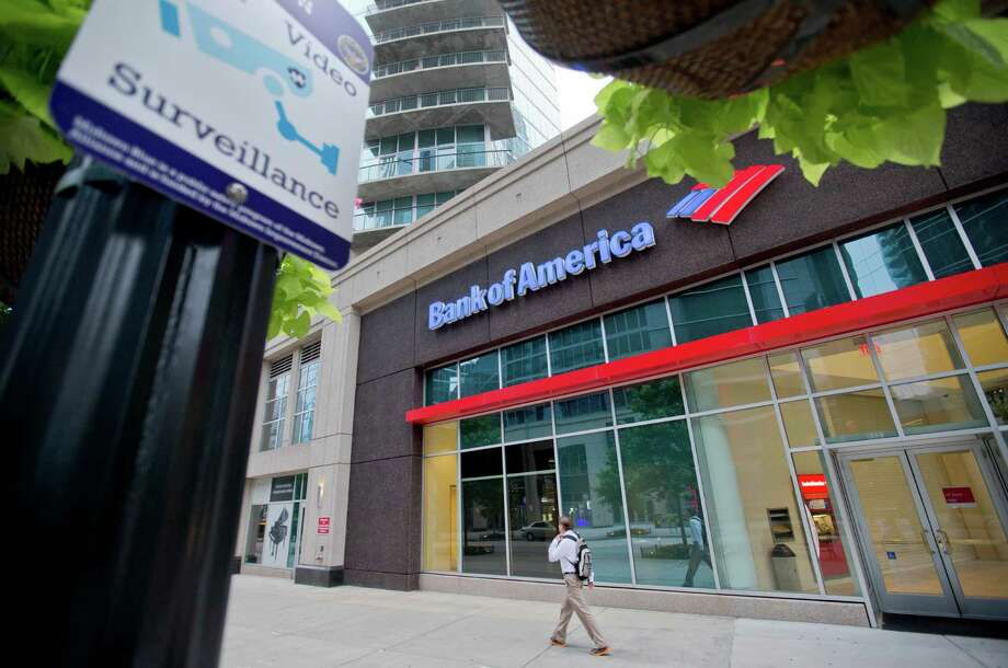 Bank of America operates this branch in Atlanta. The Justice Department plans a $16.7 billion settlement over accusations that the bank duped investors into buying toxic mortgage securities.  Photo: David Goldman, STF / AP