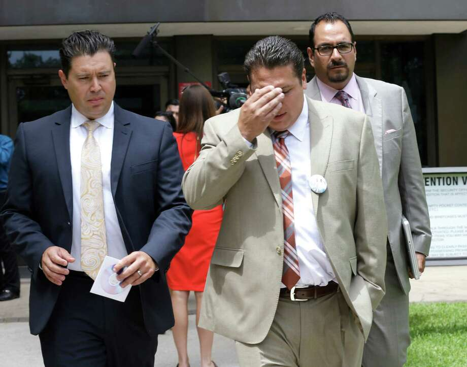 David Barajas, center, walks outside an Angleton courthouse Wednesday. He is accused of fatally shooting Jose Banda in 2012, minutes after Banda plowed into a pickup that Barajas and his two sons had been pushing. His sons were killed. Photo: Pat Sullivan, STF / AP