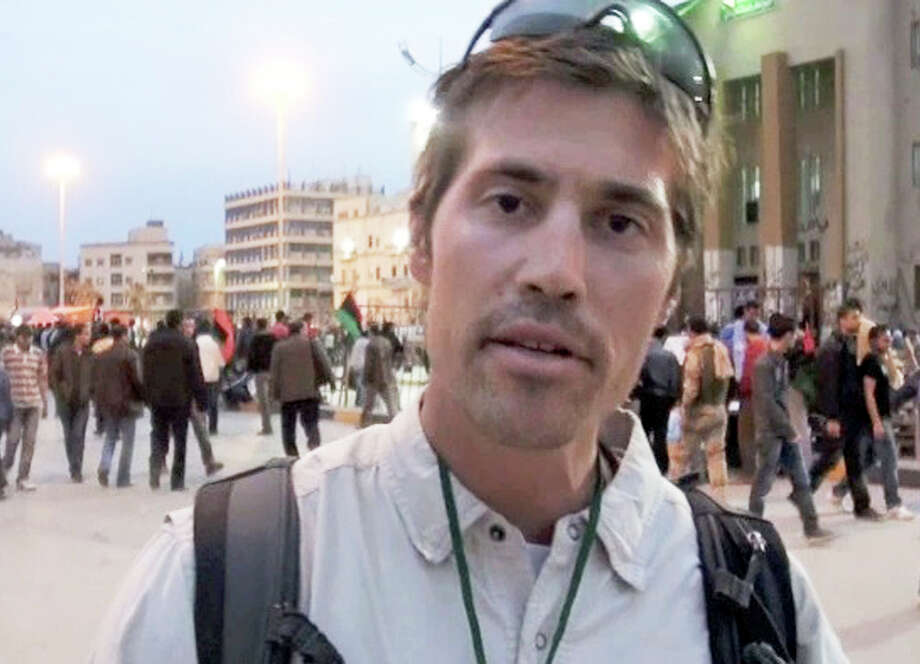 FILE - This undated file still image from video released April 7, 2011, by GlobalPost, shows James Foley of Rochester, N.H., a freelance contributor for GlobalPost, in Benghazi, Libya. In a horrifying act of revenge for U.S. airstrikes in northern Iraq, militants with the Islamic State extremist group have beheaded Foley — and are threatening to kill another hostage, U.S. officials say. (AP Photo/GlobalPost, File) ORG XMIT: NY124 Photo: Uncredited / GlobalPost