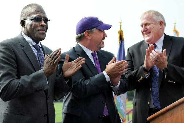 UAlbany president Robert J. Jones, left, and head football coach Greg Gattuso, right, welcome Mark Benson, center, who was named as UAlbany's new director of athletics Tuesday, Aug. 20, 2014, during a news conference at Bob Ford Field in Albany, N.Y. (Cindy Schultz / Times Union) Photo: Cindy Schultz / 00028260A