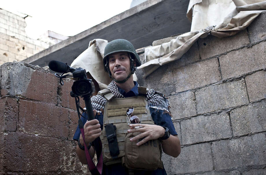 American journalist James Foley, in an act of revenge for U.S. airstrikes in northern Iraq, was beheaded by militants with the Islamic State extremist group, which is now threatening to kill another hostage. Photo: Nicole Tung / Associated Press / freejamesfoley.org