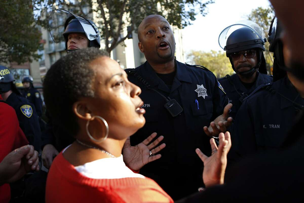 Oakland Police Sgt. Bobby Hookfin talks with Jeralynn Blueford after a protest march in support of Ferguson, Missouri residents was stopped short of police headquarters in Oakland, Calif. on Wednesday, August 20, 2014.