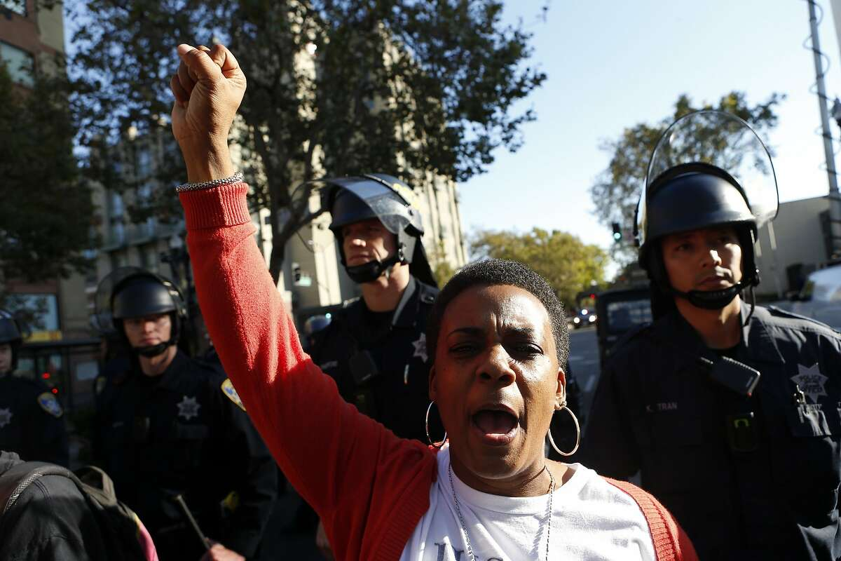 Jeralynn Blueford stands in defiance after police stopped a protest march in support of Ferguson, Missouri residents from reaching police headquarters in Oakland, Calif. on Wednesday, August 20, 2014.