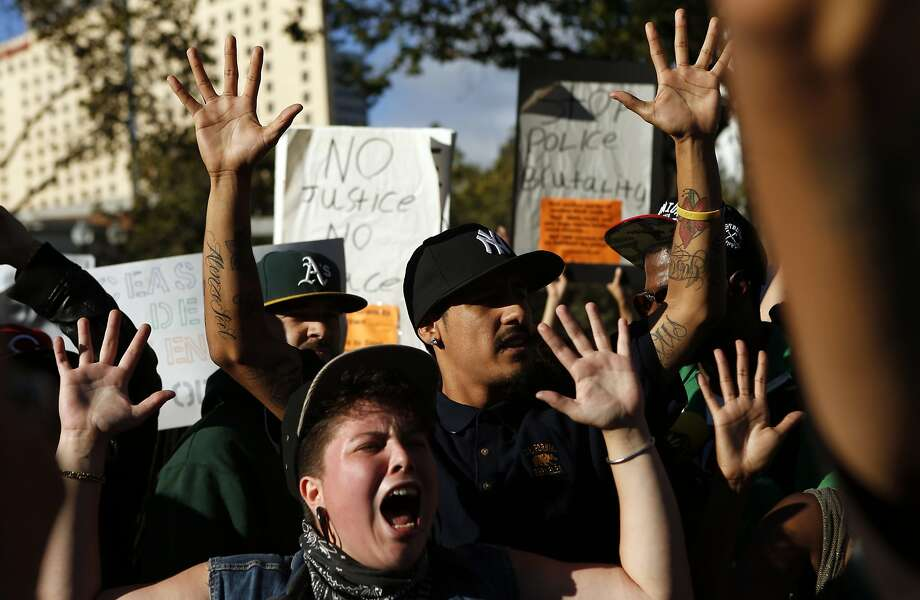 In August, protesters in support of Ferguson, Missouri residents chant after being stopped on Broadway  by police while trying to march to police headquarters in Oakland.  The city is warning residents and merchants to prepare for possible riots