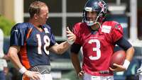 Getting some pointers from Peyton - Photo