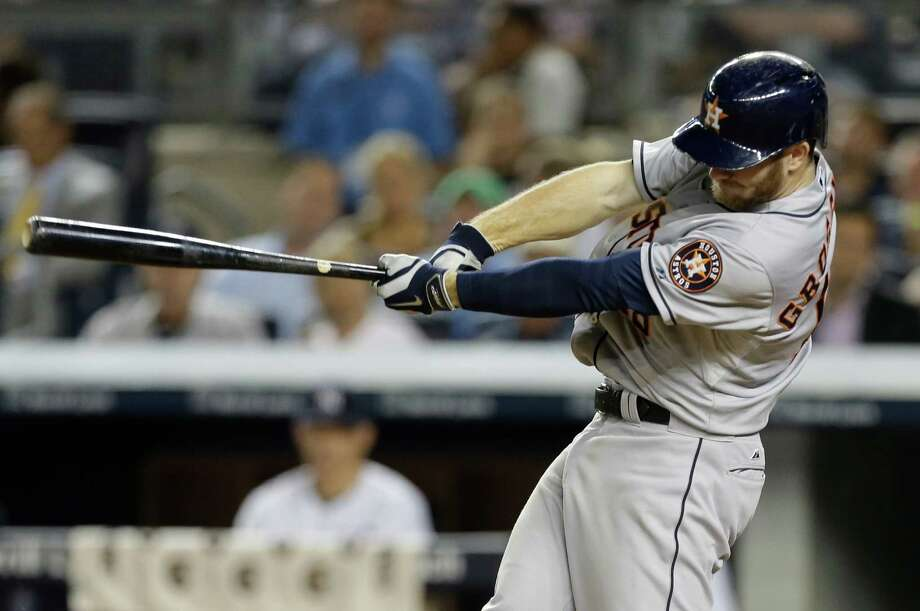 Houston Astros' Robbie Grossman follows through on a two run single during the seventh inning of a baseball game against the New York Yankees Wednesday, Aug. 20, 2014, in New York. (AP Photo/Frank Franklin II) Photo: Frank Franklin II, STF / AP