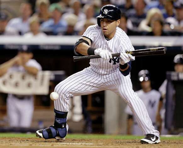 New York Yankees' Jacoby Ellsbury bunts during the fifth inning of a baseball game against the Houston Astros Wednesday, Aug. 20, 2014, in New York. New York Yankees' Ichiro Suzuki, of Japan, scored on the play. (AP Photo/Frank Franklin II) ORG XMIT: NYY108 Photo: Frank Franklin II / AP