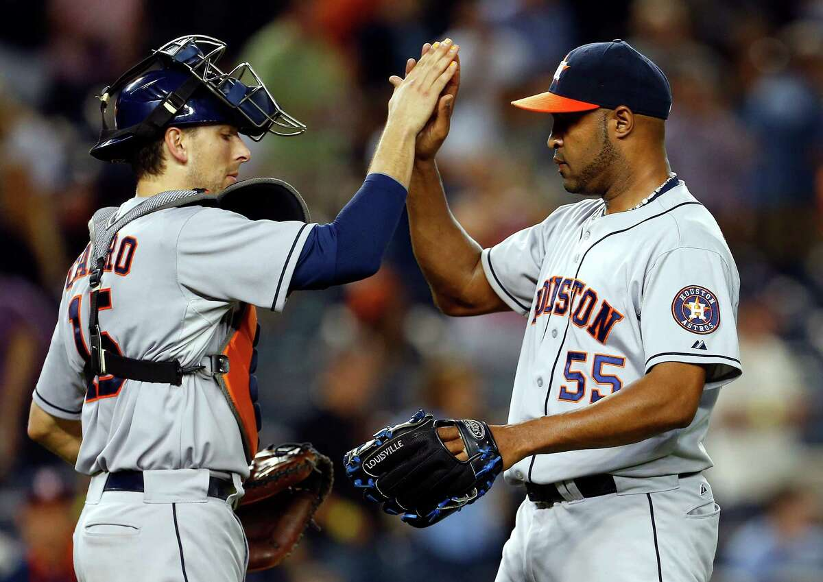 Exchanging high-fives after wins has been a more frequent occurrence this year than last for the Astros' Jose Veras, right, Jason Castro and their teammates.
