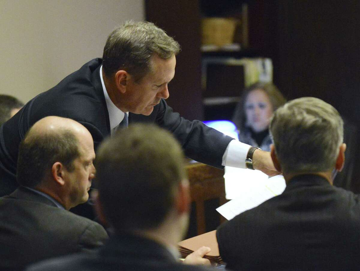 Mike McCrum (top), seen on Jan. 17, is the former federal prosecutor a San Antonio judge picked to investigate an ethics complaint against Perry that resulted in the governor's indictment.