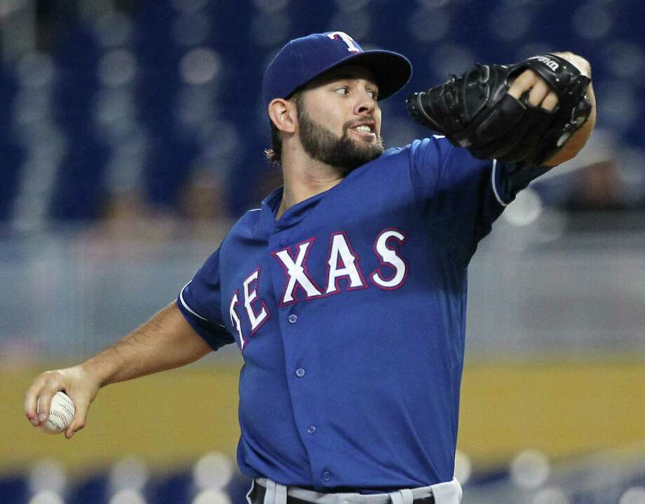 The Rangers' Nick Martinez, who pitched at Miami's Belen Jesuit Prep growing up, held the Marlins in check over his six innings. He allowed two runs and struck out a career-high seven. Photo: David Santiago / McClatchy-Tribune News Service / Miami Herald