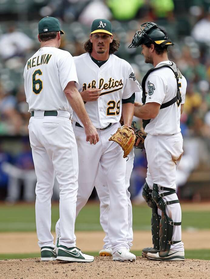 A's starter Jeff Samardzija is removed from the game by A's manager Bob Melvin after allowing seven runs in 32/3 innings. Although Samardzija has lost two straight starts, the team is 6-3 in nine starts since he arrived after a trade with the Cubs. Photo: Scott Strazzante, The Chronicle