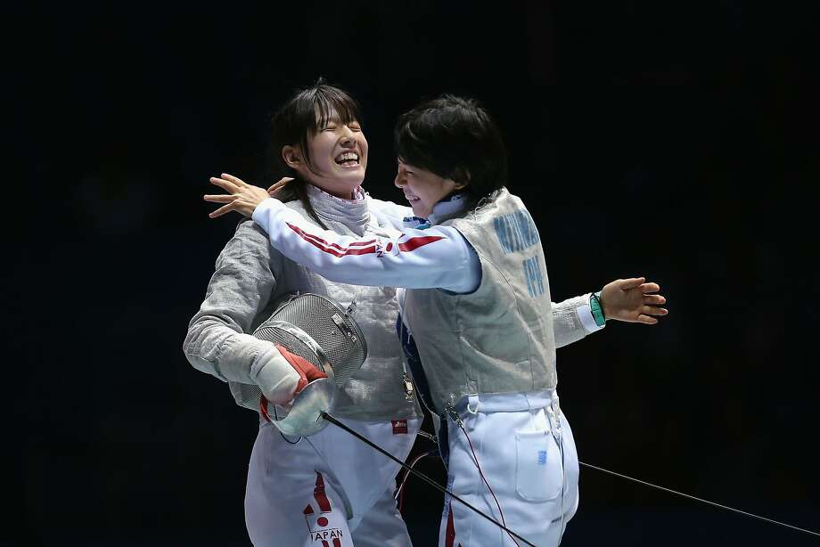 NANJING, CHINA - AUGUST 20:  Misaki Emura (L) and Karin Miyawaki (R) of Japan celebrate winning Fencing Mixed Continental Team Gold Medal Bout on day four of the Nanjing 2014 Summer Youth Olympic Games at Nanjing International Expo Centre on August 20, 2014 in Nanjing, China.  (Photo by Feng Li/Getty Images) *** BESTPIX *** Photo: Feng Li, Getty Images