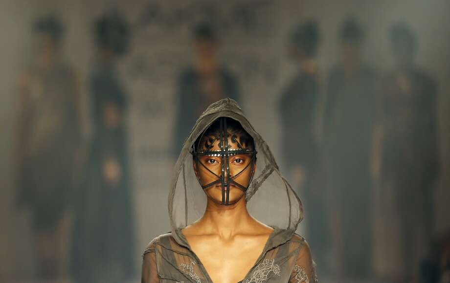 A model displays a creation by a Gen Next designer during the first day of the Lakme Fashion Week in Mumbai, India, Wednesday, Aug. 20, 2014. (AP Photo/Rajanish Kakade) Photo: Rajanish Kakade, Associated Press