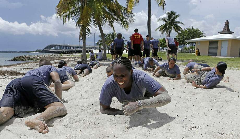 Miami Police Academy Class, PAC, 106 perform team building exercises at Hobie Beach in Key Biscayne, Fla., Wednesday, Aug. 20, 2014. (AP Photo/Alan Diaz) Photo: Alan Diaz, Associated Press