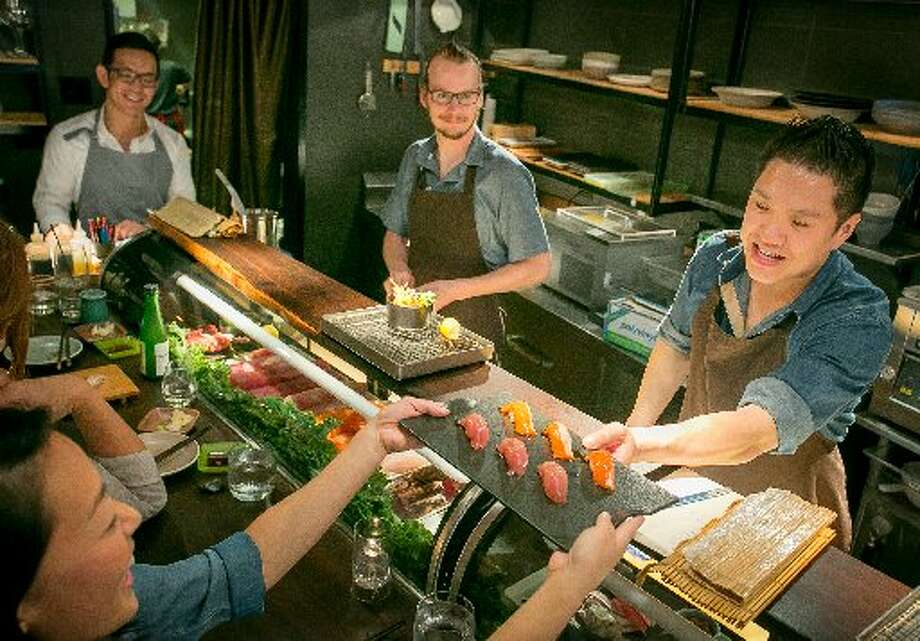 Geoffrey Lee, the new chef at Akiko's, prepares sushi. Photo: John Storey, The Chronicel 2013