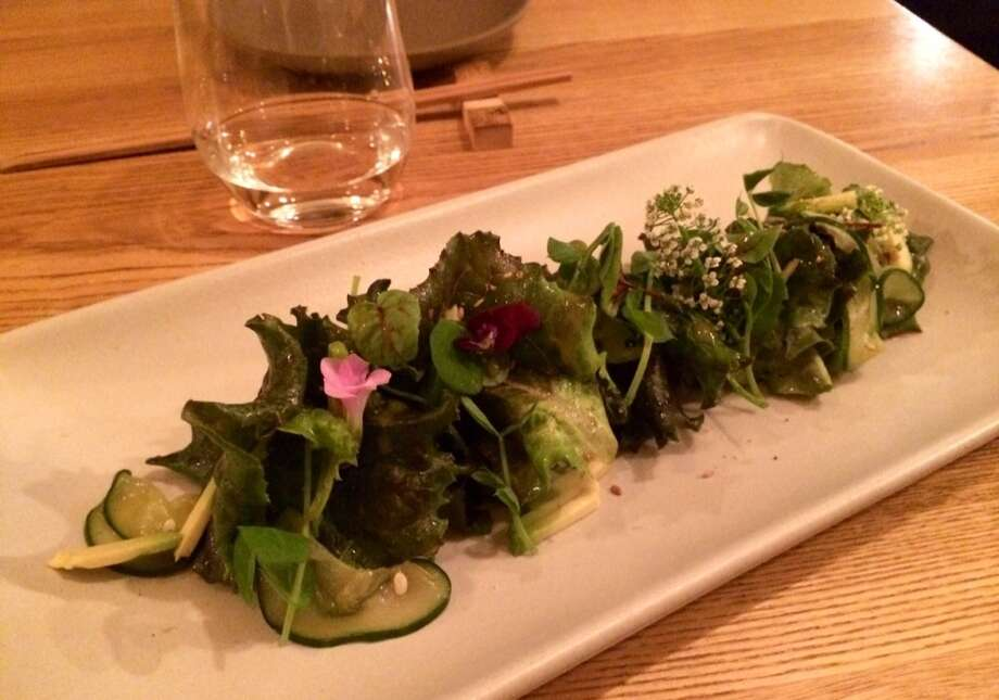 The omakase dinner begins with a salad with a soy dressing.