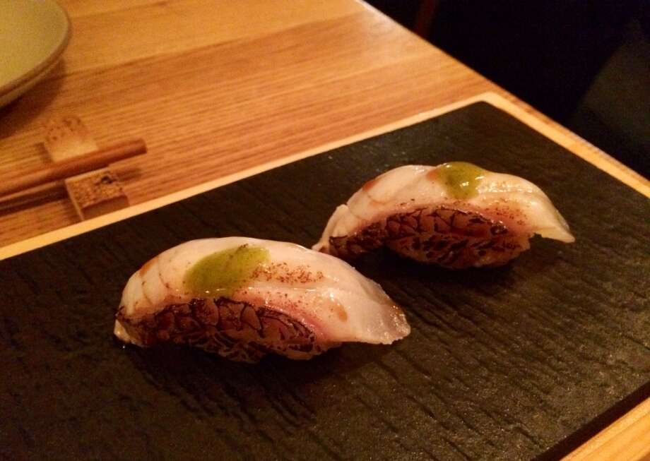 Sea bream is topped with a soy and shisho emulsion.