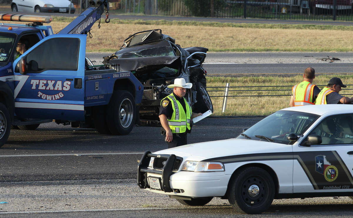 A vehicle involved in a fatal accident in south Bexar County is removed by a wrecker Thursday August 21, 2014 on IH-35 southbound near Kinney Road. The accident involved two cars and an 18-wheeler truck and took place about 3:00 a.m.. Traffic on I-35 South has been diverted to the feeder road.