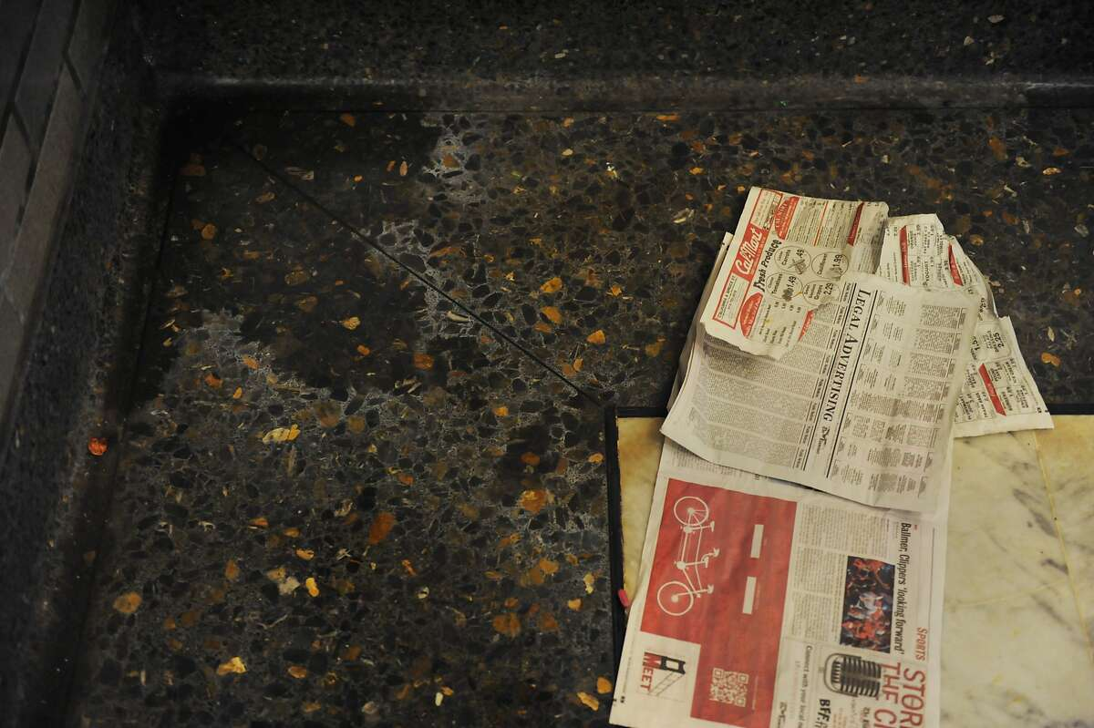 Litter and urine are seen in a corner inside the Civic Center BART station on August 20, 2014 in San Francisco, CA.