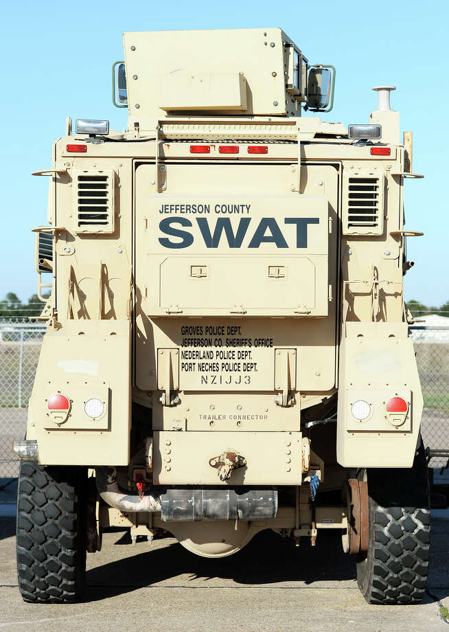 """SWAT"" and a list of local offices are listed on the back of the county's MRAP vehicle. The Jefferson County Sheriff's Department has acquired a used Mine Resistant Ambush Protected vehicle from the military. The armored vehicle can be used for rescues and cover in the case of an active shooter situation. Photo taken Jake Daniels/@JakeD_in_SETX Photo: Jake Daniels / ©2013 The Beaumont Enterprise/Jake Daniels"