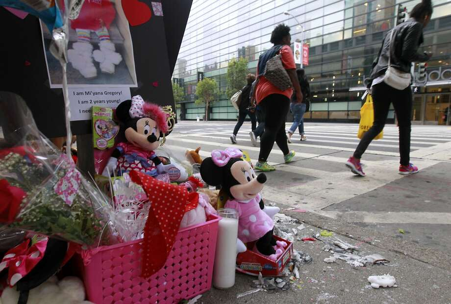 A memorial for Mi'yana Gregory, 2, continues to grow on Mission Street. Photo: Paul Chinn, The Chronicle