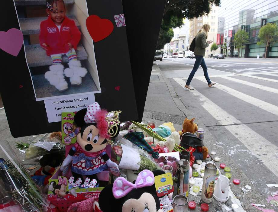 A memorial honors 2-year-old Mi'yana Gregory, killed in a crosswalk on Mission between Fourth and Fifth streets in S.F. Photo: Paul Chinn, The Chronicle