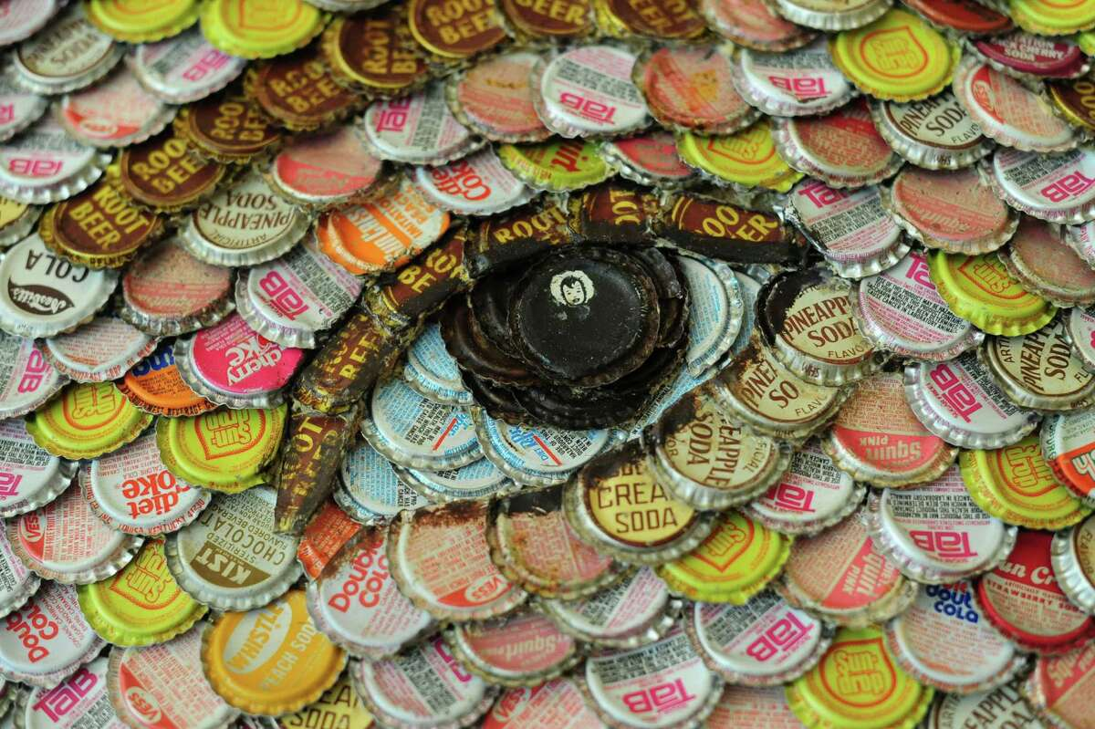 A portrait of Meagan Stanley, daughter of Dickey and Cinda Stanley, is by Molly B. Right, who works with bottle caps.