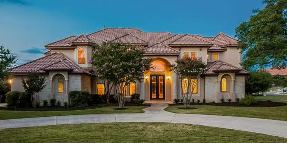 """19 Champions WaySan Antonio, TX Bedrooms: 5Full Baths: 4, 1 partialNeighborhood: Champions Ridge5,703 sqft""""Gorgeous columns frame formal drive brick accents. Sleek, modern kitchen with granite counters, recessed lighting, and expansive island."""" Photo: Keller Williams Realty Luxury"""