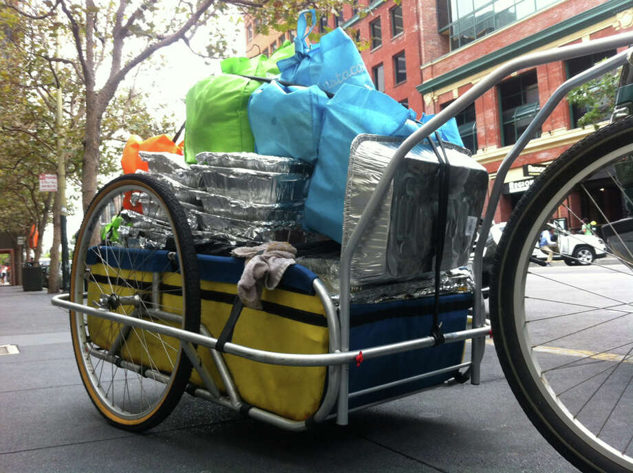 The Food Runners cargo bike completely loaded with donated food. Photo: Food Runners