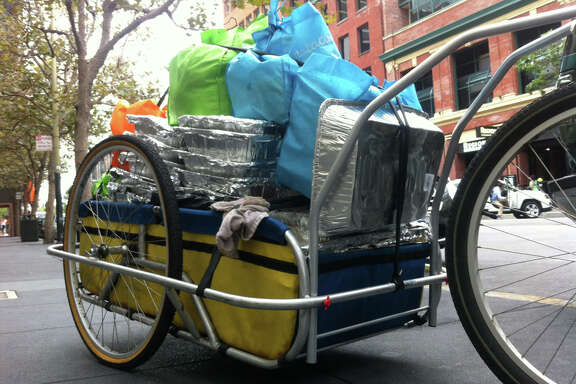 The Food Runners cargo bike completely loaded  with donated food.