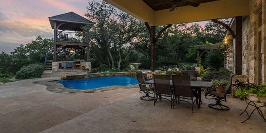 "3921 Fossil Rock San Antonio, TX Bedrooms: 4Full Baths: 4, 1 partialNeighborhood: Fossil Ridge5,975 sqft""Total privacy with pool/spa and an observation deck with amazing views."" Photo: Keller Williams Realty Luxury"