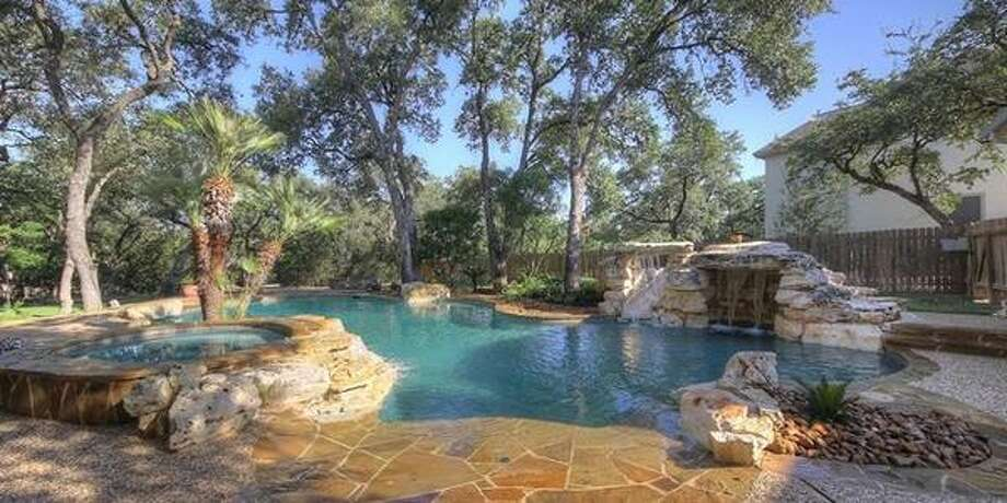 "25103 Callaway San Antonio, TXBedrooms: 6Full Baths: 4, 1 partialNeighborhood: Summerglenn6,974 sqft""Deep pool with grotto and lush tropical landscaping."" Photo: Keller Williams Realty Luxury"