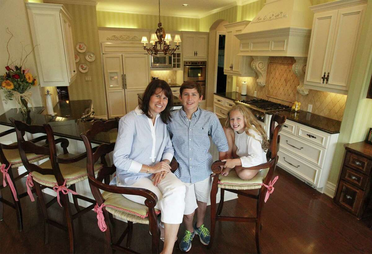 Meggan Leonard, her son Matt and daughter, Madelyn, all enjoy cooking in the kitchen of their home in Terrell Hills. Meggan planned the kitchen with durable finishes and child-friendly features so the kids would feel comfortable.